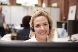 female customer service agent working at her desk using voip technology